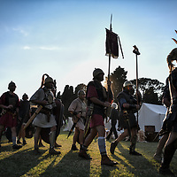 Aquileia, Italy - 17 June 2018: Roman legionaries march bringing the army insignia during Tempora in Aquileia, ancient Roman historical re-enactment