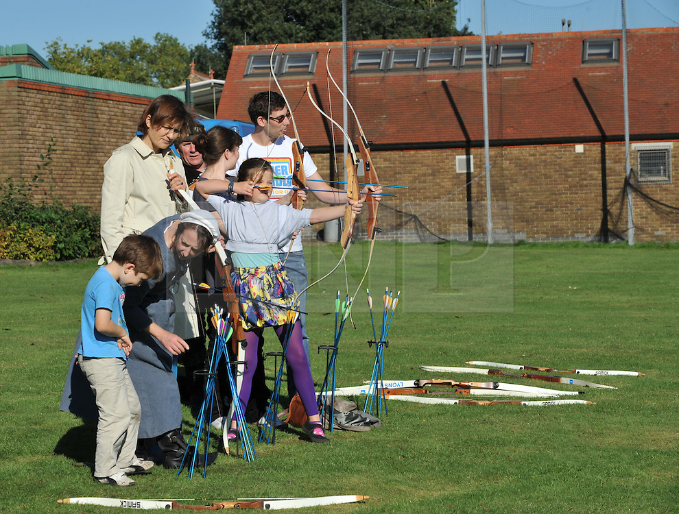 © Copyright licensed to London News Pictures. 06/10/2010. Archery practice, Parliament Hill, Hamsptead Heath, London. The Annual Heath Heritage Festival hosts the annual Hampstead Heath Conker Competition. Representatives of the RSPB, National Trust, volunteer group Heath Hands, local beekeepers and woodworkers were in attendance.