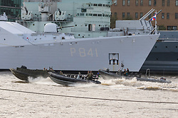 © Licensed to London News Pictures. 23/10/2018. London, UK. Dutch Royal Netherlands Marines and Royal Marines in RIB's alongside HMS Belfast and HNLMS Zeeland during a rehearsal for a display tomorrow when the Royal Marines and Royal Netherlands Marines will stage a joint on water capability demonstration with blank ammunition. As part of the Dutch state visit, King Willem-Alexander and Queen Máxima will attend the Dutch ship HNLMS Zeeland, which is anchored next to HMS Belfast. They will join The Duke of Kent on board and will be given a 10 minute display of the Royal Marines and Royal Netherlands Marines staging a joint on water capability demonstration.Photo credit: Vickie Flores/LNP