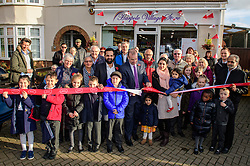 Pictured is Chris Heaton-Harris MP, front centre, cutting the ribbon to officially open the new Harpole Post Office at Harpole Village Store.<br /> <br /> Chris Heaton-Harris MP has officially opened the new Harpole Post Office at Harpole Village Store in High Street, Harpole, Northampton.<br /> <br /> Date: November 10, 2017