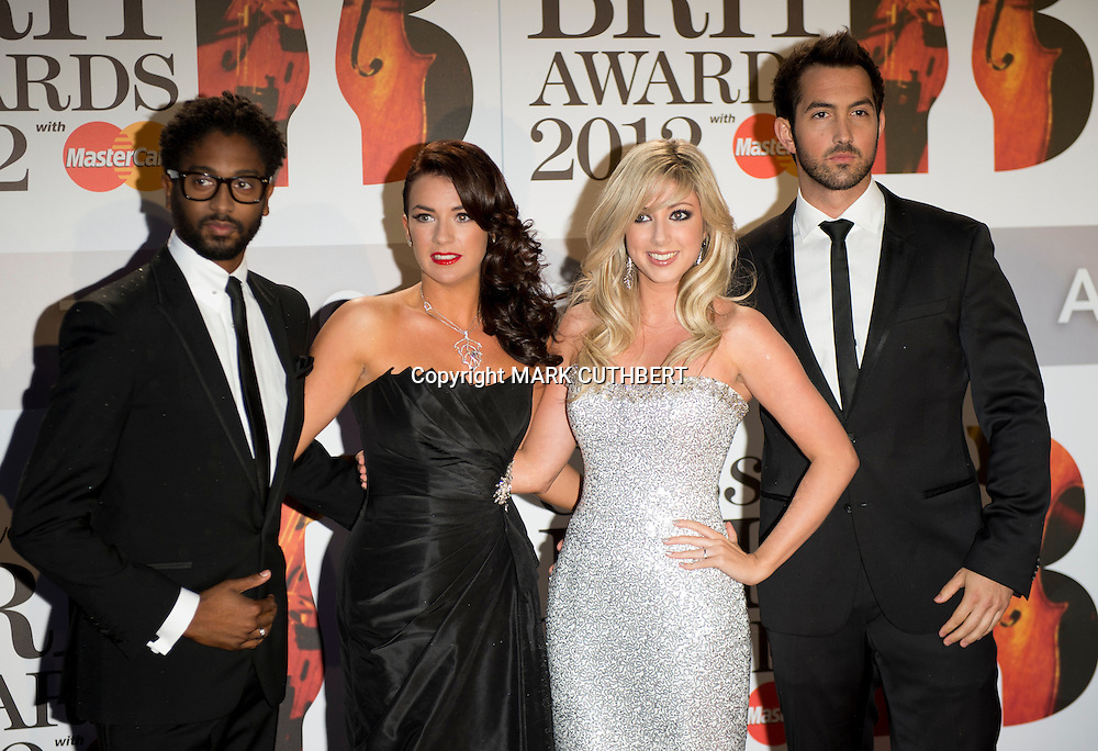 Peter Braithwaite, Monica McGhee, Victoria Gray and David Gray of the group Amore arriving at the 2012 Classic Brit Awards at the Royal Albert Hall in London.