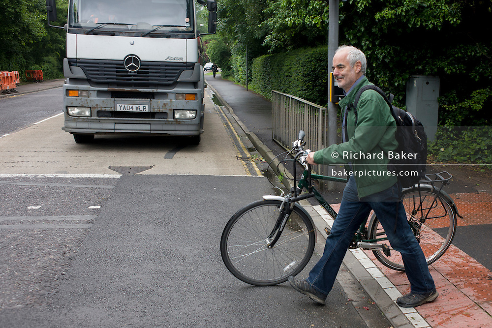 Mathematician and Risk guru, Professor David Spiegelhalter at the Centre for Mathematical Sciences, crosses the road while out and about in Cambridge.