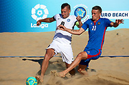 CATANIA, ITALY - AUGUST 16: Nicolae Ignat of Moldova competes for the ball with Rasmus Munskind of Estonia during the Euro Beach Soccer League match between Moldova and Estonia on August 16, 2019 in Catania, Italy. (Photo by Quality Sport Images