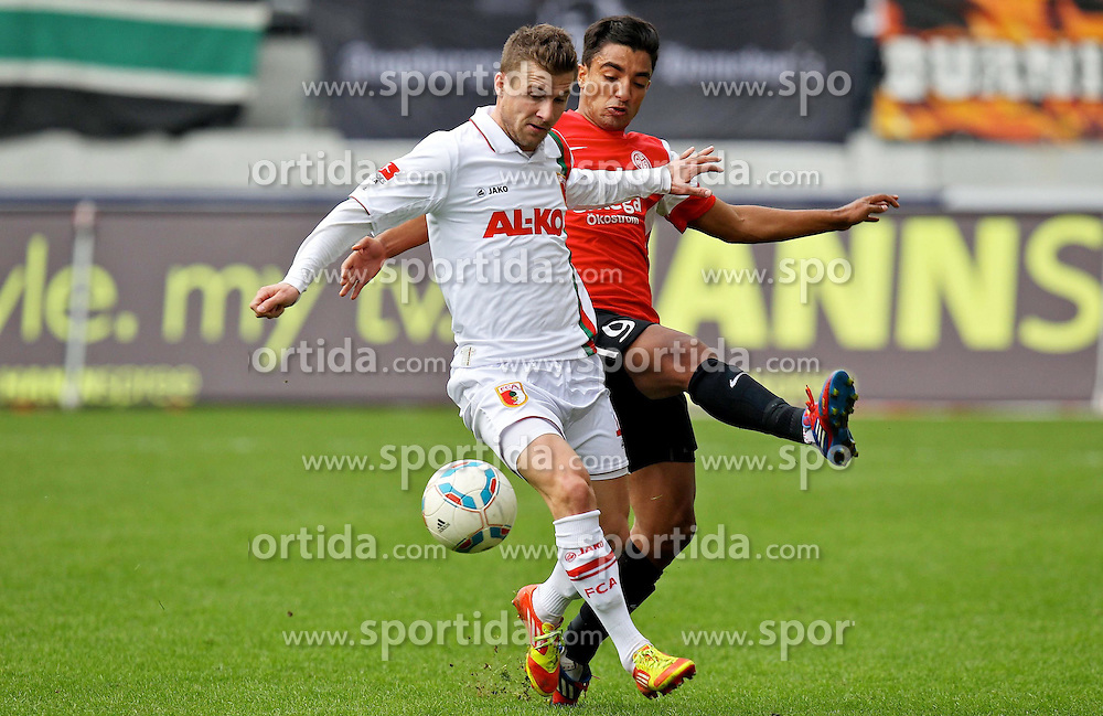 17.03.2012, SGL Arena, Augsburg, GER, 1. FBL, FC Augsburg vs Mainz 05, 26. Spieltag, im Bild Zweikampf zwischen Daniel BAIER (# 10, FC Augsburg) und Sami Allagui (# 9, Mainz 05) v.l. // during the German 'Bundesliga' Match, 26th Round, between FC Augsburg and Mainz 05 at the SGL Arena, Augsburg, Germany on 2012/03/17. EXPA Pictures © 2012, PhotoCredit: EXPA/ Eibner/ Peter Fast..***** ATTENTION - OUT OF GER *****
