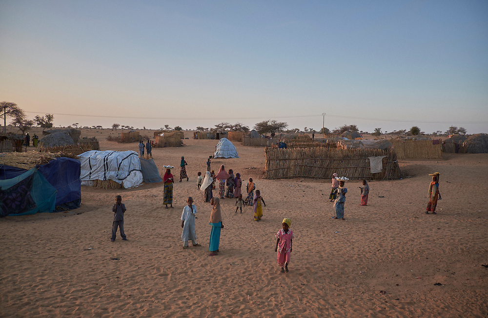 A camp of displaced people in the neighbourhood of Chateau, Diffa, Niger on February 12, 2016. The camp is mixed between displaced people from Niger, Nigeria and Chad. They have fled attacks by the militant group Boko Haram on their villages and it's ongoing conflicts with the armies of each country. Caritas undertook a distribution of mosquito nets, cooking pots, sleeping covers, hygiene kits, clothes and cash transfers to the displaced. 228 households received support from Caritas among an estimated 1500 households in the  vicinity of Chateau. There is still great need. There is no school system in place for the children and the housing is not adequate for many as more people arrive each day escaping hostilities.