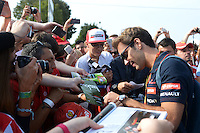 Jean-Eric Vergne (FRA) Scuderia Toro Rosso signs autographs for the fans.<br /> Italian Grand Prix, Sunday 7th September 2014. Monza Italy.