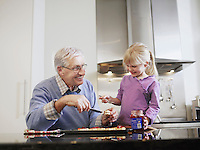 Grandfather and Granddaughter Making Cookies