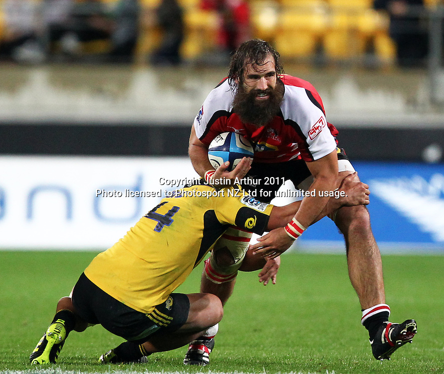 Lions Joshua Strauss on the attack.Investec Super 15 rugby match - Hurricanes v Lions, at Westpac Stadium, Wellington, New Zealand on Saturday 4 June 2011. Photo: Justin Arthur / photosport.co.nz