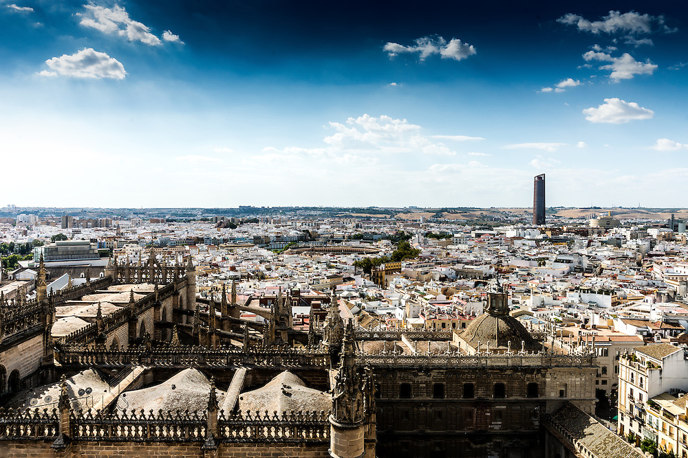 Beautiful Skyline of Seville Spain during mid-day Cityscape series travels throughout the world capturing cities in their architecture glory .