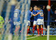 Portsmouth players celebrate Portsmouth striker Caolan Lavery opening goal during the Sky Bet League 2 match between Portsmouth and Hartlepool United at Fratton Park, Portsmouth, England on 12 December 2015. Photo by Adam Rivers.