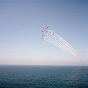 Aircraft of the 'Red Arrows', Britain's Royal Air Force aerobatic team practice over Cyprus sea during Spring exercises.