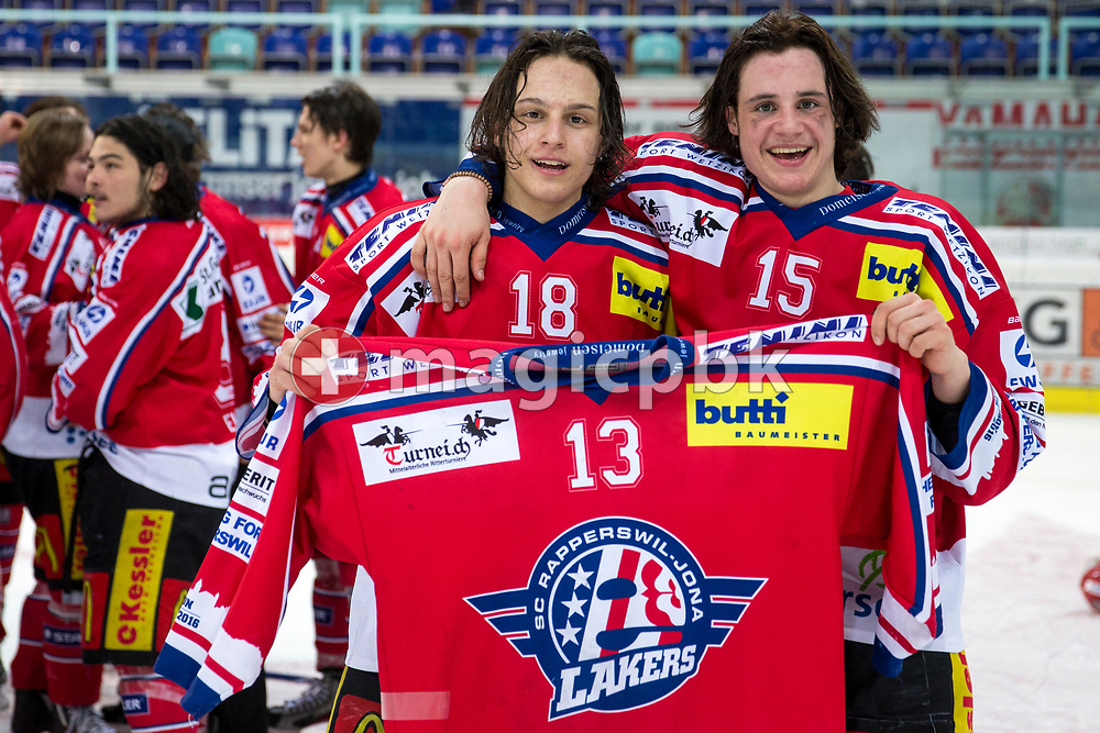 Rapperswil-Jona Lakers forward Toni Szabo (L) and Manuel Laimbacher honour their teammate Dimitri Beer (#13), who missed the game due to military service, after wining the Swiss championships and the fifth Elite B Playoff Final ice hockey game between Rapperswil-Jona Lakers and ZSC Lions held at the SGKB Arena in Rapperswil, Switzerland, Sunday, Mar. 19, 2017. (Photo by Patrick B. Kraemer / MAGICPBK)