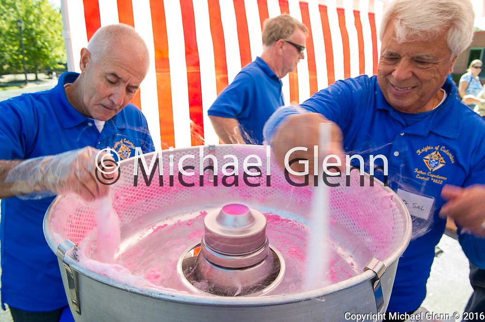 15 Oct. 2016 Forked River USA / John and Dr. Sal of the Knights of Columbus COUNCIL #6522<br /> FATHER CAPODANNO COUNCIL in Forked River make cotton candy for the children as St Pius X celebrates it's 10th year in their new church with a festival open to all  /  Michael Glenn  / Glenn Images