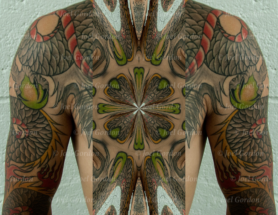 Close up of Chinese Dragon tattoo on left shoulder and body.<br /> <br /> Body art or tattoos has entered the mainstream it is no longer considered a weird kind of subculture.<br /> <br /> <br /> &quot;According to a 2006 Pew survey, 40% of Americans between the ages of 26 and 40 have been tattooed&quot;.