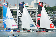 Gazprom Team Russia, Emirates Team New Zealand and Alinghi. Day three of the Extreme Sailing Series regatta being sailed in Singapore. 22/2/2014