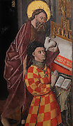 Portrait of the donor Philippe de Ternant, wearing his armorial colours and the Order of the Golden Fleece, kneeling in front of an altar, presented by St John the Baptist with his lamb, from the Altarpiece of the Virgin, 1430-40, in the Eglise de Saint-Roch, Ternant, Nievre, Burgundy, France. The altarpiece was commissioned by Philippe de Ternant and his wife Isabeau de Roye, and depicts 7 scenes of the Life of the Virgin, both painted and sculpted, including the Annunciation, Dormition and Glorification. It was made by Brabant and Flemish workshops in painted and gilded carved wood. The altarpiece has been restored many times and is listed as a historic monument. Picture by Manuel Cohen
