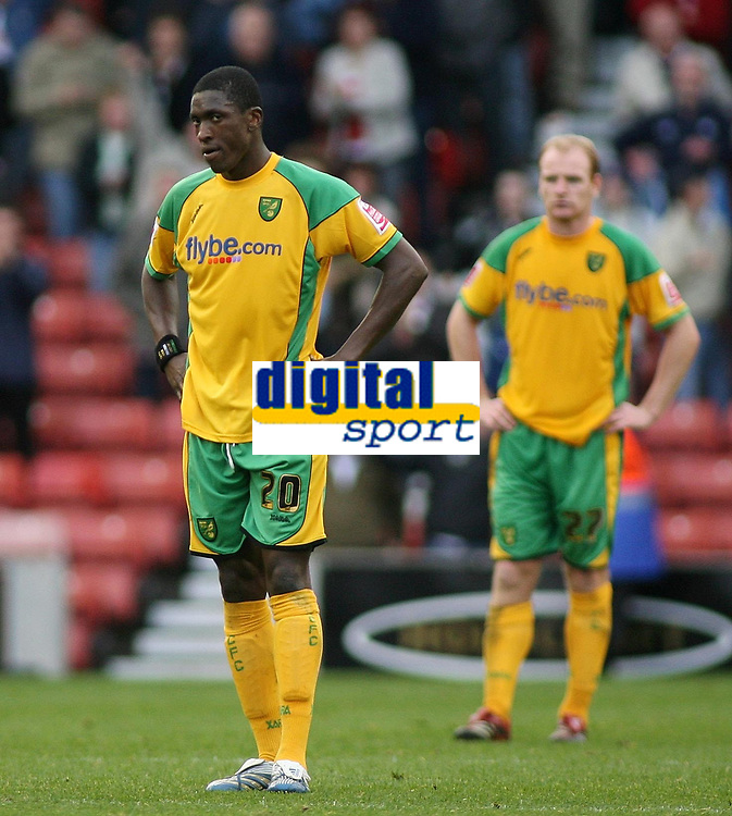 Photo: Paul Thomas.<br /> Stoke City v Norwich City. Coca Cola Championship. 28/10/2006.<br /> <br /> Dejected Norwich player Dickson Etuhu (L) and Gary Doherty can;t believe it as they loose 5-0.