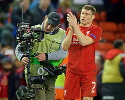 LIVERPOOL, ENGLAND - Thursday, February 25, 2016: Liverpool's match winning goal scorer James Milner applauds the supporters after the 1-0 victory over FC Augsburg during the UEFA Europa League Round of 32 1st Leg match at Anfield. (Pic by David Rawcliffe/Propaganda)