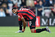 Callum Wilson (13) of AFC Bournemouth ties his boot laces during the Premier League match between Bournemouth and Norwich City at the Vitality Stadium, Bournemouth, England on 19 October 2019.