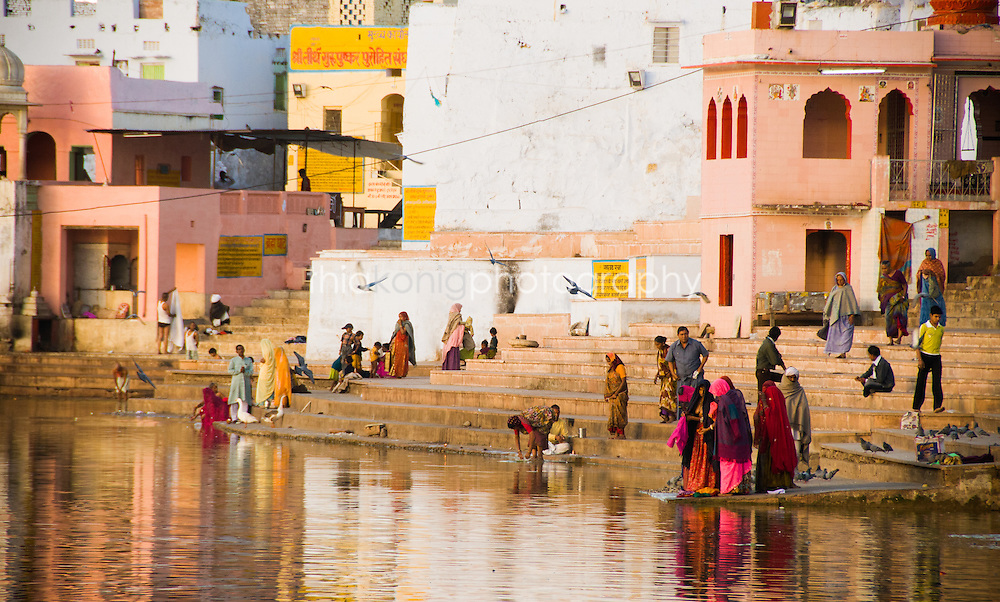 Pilgrims wash laundry and bathe in the holy waters of Pushkar Lake, Rajasthan, India.