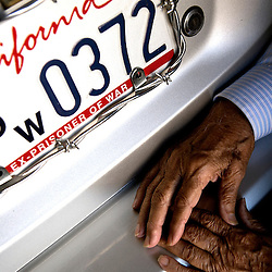 96 year-old Former U.S. Army Sgt. and World War II veteran William Sanchez next to his POW license plate that displays his prisoner number. Sanchez is a former prisoner of war for three years and has been invited by the Japanese government along with his fellow POWs to Japan to revisit the campsite that was their prison so that they could gain a sense of closure in Monterey Park, Calif., Friday, Nov. 7, 2014.