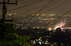 Unauthorized fireworks explode above the Fruitvale district of Oakland, Calif., to celebrate the 242nd anniversary of American independence, Wednesday, July 4, 2018. (Photo by D. Ross Cameron)