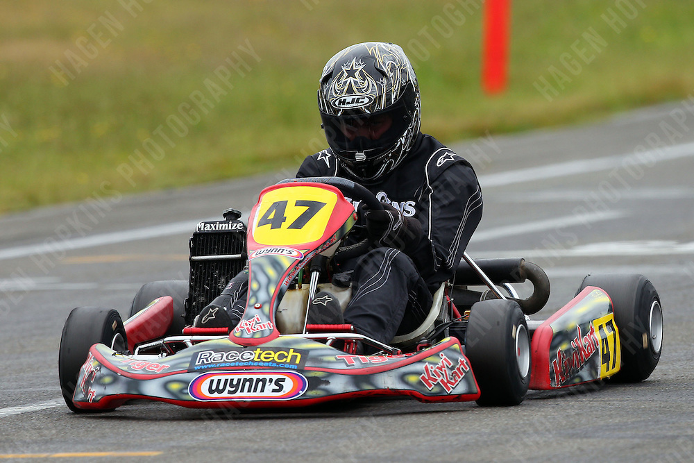 Ashley Higgins, 47, races in the Rotax Light class during the 2012 Superkart National Champs and Grand Prix at Manfeild in Feilding, New Zealand on Saturday, 7 January 2011. Credit: Hagen Hopkins.