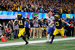 Michigan Wolverines running back Christian Turner #41 runs the ball during the Chick-fil-A Peach Bowl, Saturday, December 29, 2018, in Atlanta. ( Paul Abell via Abell Images for Chick-fil-A Peach Bowl)
