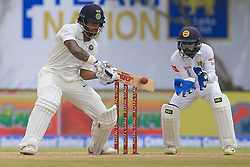 July 26, 2017 - Galle, Sri Lanka - Indian cricketer Shikhar Dhawan(L) plays a shot during the 1st Day's play in the 1st Test match between Sri Lanka and India at the Galle International cricket stadium, Galle, Sri Lanka on Wednesday 26 July 2017. (Credit Image: © Tharaka Basnayaka/NurPhoto via ZUMA Press)