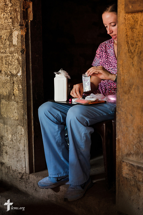 Molly Christensen, career missionary to Togo, fills prescriptions in the pharmacy on the fifth day of the LCMS Mercy Medical Team on Friday, May 11, 2018, in the Yardu village outside Koidu, Sierra Leone, West Africa. LCMS Communications/Erik M. Lunsford