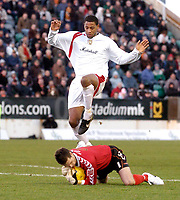 Photo: Leigh Quinnell.<br /> Milton Keynes Dons v Barnet. Coca Cola League 2. 20/01/2007. MK Dons Clive Platt jumps to avoid Barnet goalkeeper Ross Flitney.