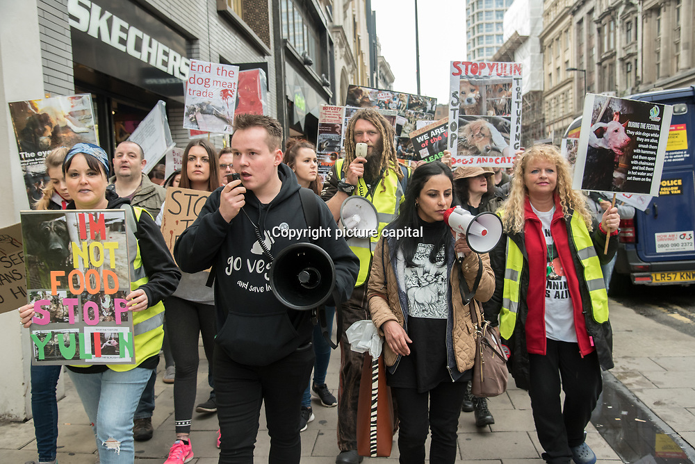 "London, UK. 27 April 2018: noise Animal rights activists assembly at Convent Garden march to the Chinese Embassy demand the Chinese Yulin ""Festival"" to stop."