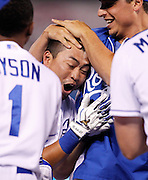 Kansas City Royals' Norichika Aoki, center, is congratulated by his teammates after hitting in the game-winning run in the 14th inning of a baseball game against the Cleveland Indians at Kauffman Stadium in Kansas City, Mo., Thursday, July 24, 2014.  (AP Photo/Colin E. Braley)