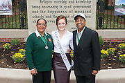 Ohio University President, Roderick McDavis, and Ohio University First Lady, Deborah McDavis, pose with Sharmaine Wilcox, a member of Ohio University's Homecoming Court, at the College Gateway on October 8, 2016.
