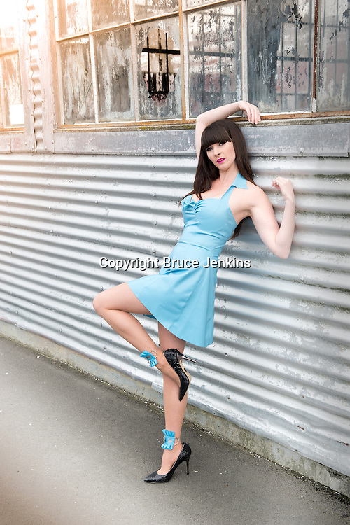Loran Hosegood modelling blue latex dress made by Eliza-May Tolhurst, photography by Bruce Jenkins