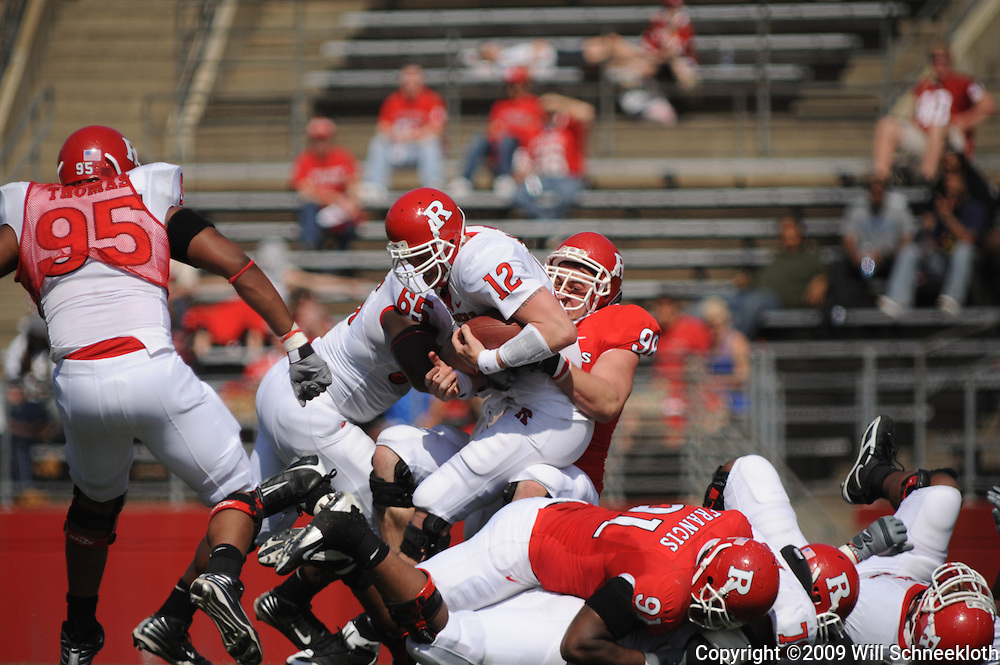 Apr 18, 2009; Piscataway, NJ, USA; Rutgers QB Steve Shimko (12) is wrestled down by DE Evan Lampert (98) during the secodn half of Rutgers' Scarlet and White spring football scrimmage.
