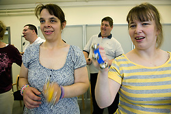 Group of Day Service users with learning disabilities playing percussion instruments,