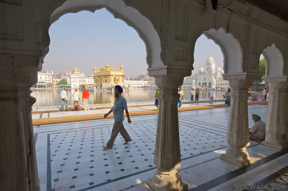 The golden temple is the Sikh religion's most holy place of peace.  Amritsar, India.