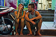 Couple chill out on Khao San Road. Bangkok, Thailand.