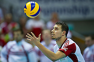 Fabian Drzyzga from Poland in action during the 2013 CEV VELUX Volleyball European Championship match between Poland v Slovakia at Ergo Arena in Gdansk on September 22, 2013.<br /> <br /> Poland, Gdansk, September 22, 2013<br /> <br /> Picture also available in RAW (NEF) or TIFF format on special request.<br /> <br /> For editorial use only. Any commercial or promotional use requires permission.<br /> <br /> Mandatory credit:<br /> Photo by © Adam Nurkiewicz / Mediasport