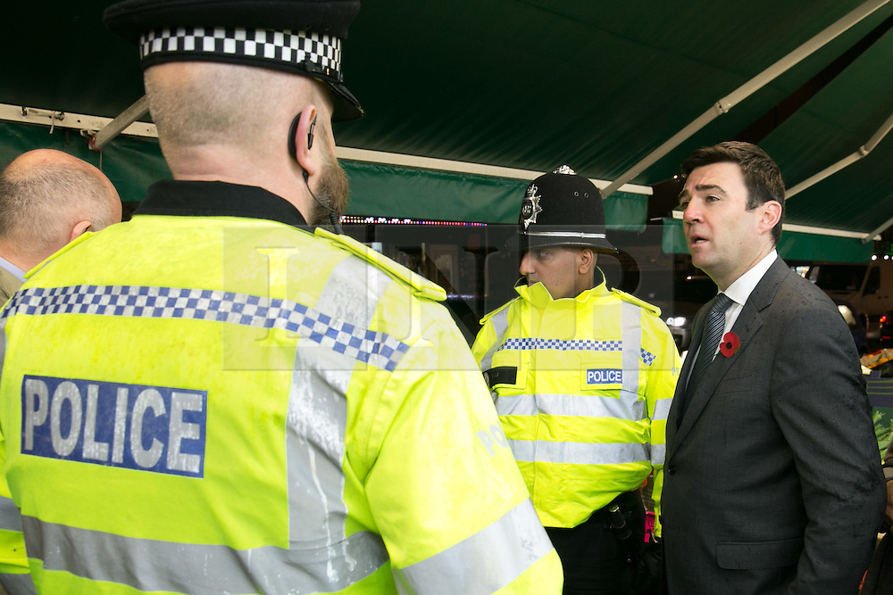© Licensed to London News Pictures. 03/11/2015. Alum Rock, Birmingham, UK. Shadow Home Secretary ANDY BURNHAM visiting Alum Rock in Birmingham to launch the Labour Policy on Policing. Pictured, from left, JACK DROMEY MP for Erdington, Inspector CHRIS SMITH, Sgt IFTI ALI, ANDY BURNHAM, on the Alum Rock Road. Photo credit : Dave Warren/LNP