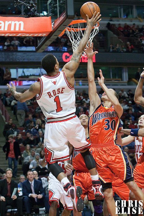 11 December 2009: Chicago Bulls guard Derrick Rose goes for the layup over Golden State Warriors guard Stephen Curry during the Chicago Bulls victory 96-91 in overtime over the Golden State Warriors at the United Center, in Chicago, Illinois, USA.
