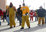 November 23 2012: Iowa Hawkeyes fans walk around the outside of the stadium before the start of the NCAA football game between the Nebraska Cornhuskers and the Iowa Hawkeyes at Kinnick Stadium in Iowa City, Iowa on Friday November 23, 2012. Nebraska defeated Iowa 13-7 in the Heroes Game on Black Friday.