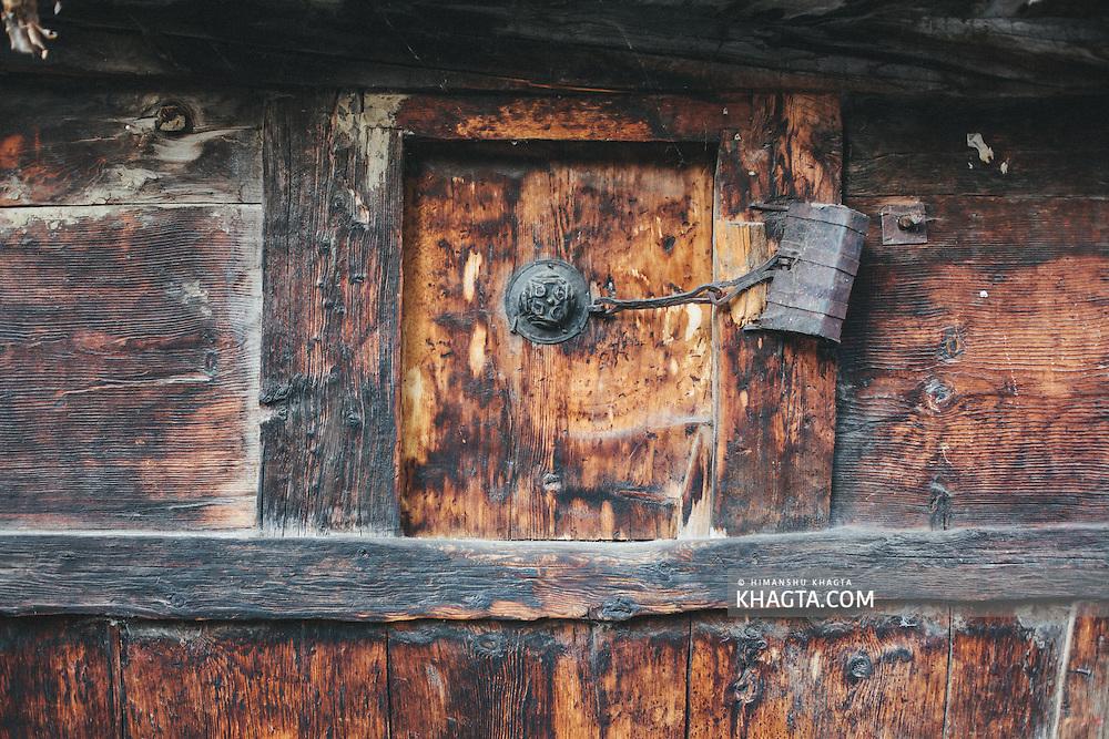 Granary door with a vintage lock in Chitkul, Kinnaur
