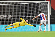 Asmir Begovic (1) of AFC Bournemouth dives the right way but is beaten by the shot from Andros Townsend (10) of Crystal Palace  in the penalty shootout during the EFL Cup match between Bournemouth and Crystal Palace at the Vitality Stadium, Bournemouth, England on 15 September 2020.