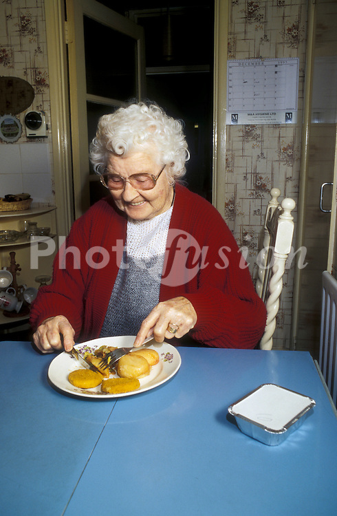 Meals on wheels client eating meal