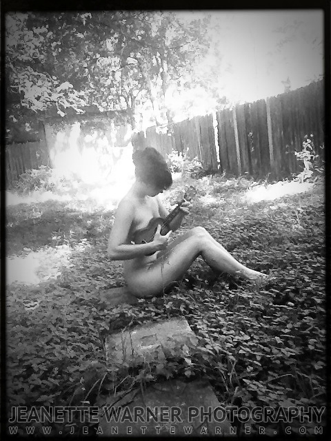 Ukulele player in the backyard in Austin, TX.