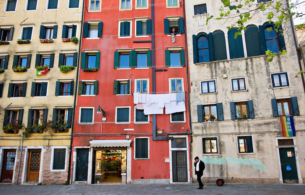 """VENICE, ITALY - NOVEMBER 15: A general view of the main """"campo"""" (square) of the Ghetto on November 15, 2011 in Venice, Italy. Established in 1516 the Ghetto of Venice was the area were Jews were compelled to live during the Venetian Republic. The English term 'ghetto' is derived from the Venetian term for 'slag' and refers to the refuse left the foundry that was located on the same island. In present times the ghetto is a multi-ethnical area area seen as the cultural heart of the city, but with five synagogues remains the centre of the of Jewish community."""