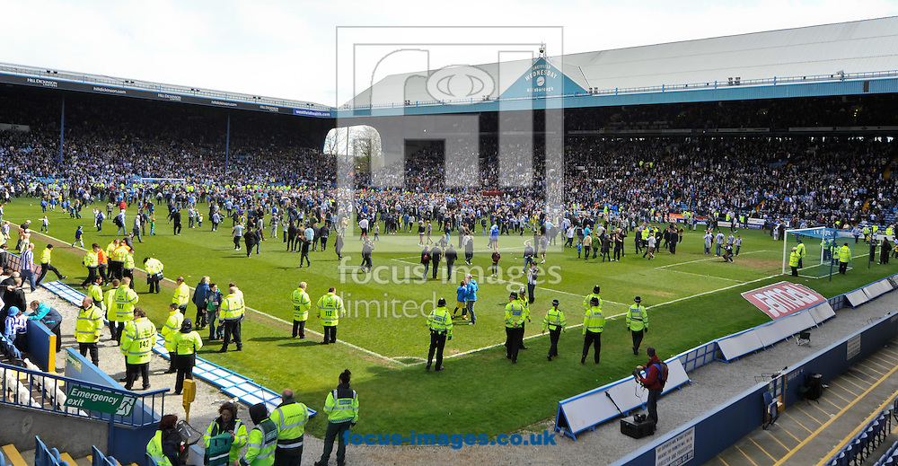 Picture by Richard Land/Focus Images Ltd +44 7713 507003.04/05/2013.Sheffield Wednesday fans invade the pitch on the final whistle to celebrate staying in the npower Championship, at Hillsborough, Sheffield.