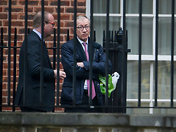 © Licensed to London News Pictures. 09/04/2019. London, UK. PHILIP MAY looks glum as he watches British Prime Minster Theresa May leave Downing Street to head to France where she will meet with Angela Merkel and Emmanuel Macron for talks, four days before the UK is due to leave the EU. Photo credit: Ben Cawthra/LNP